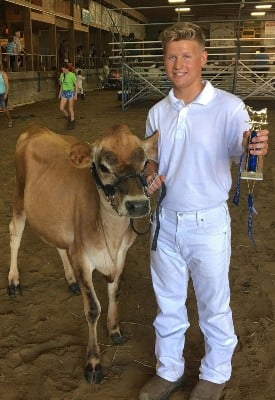 Elliott Siemen with his award winning cow.