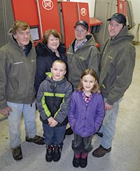 The Boettchers installed four robots on their 230-cow farm near Wykoff, Minn. Pictured (back row, from left) Curtis, Cheryle, Brian and Chad; (front) Curtis and Cheryle's grandchildren, William and Kayla Arndorfer. PHOTO BY KRISTA KUZMA