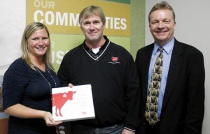 From left to right – Megan Kregel, dairy center coordinator for Northeast Iowa Dairy Foundation, Rick Rugg, regional sales manager for Lely and Dave Lawstuen, chair for dairy operations and dairy science instructor for Northeast Iowa Community College (NICC)