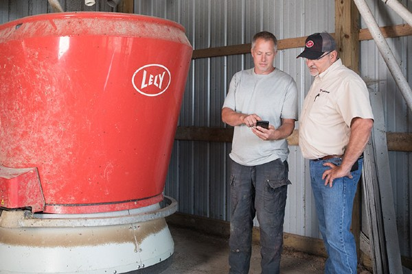 Lely product specialists with Lely vector automatic feeding system