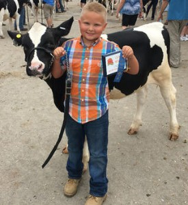 Riley Siemen with his prize winning dairy cow