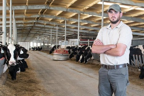 Kevin Cornett of Sweetwater Valley Farm in his robotic dairy barn.