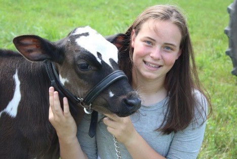 Lely scholarship winner Lynn Olthof with dairy cow