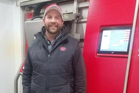 Darin Strauss of Majestic Crossing Dairy with a Lely Astronaut robotic milking machine