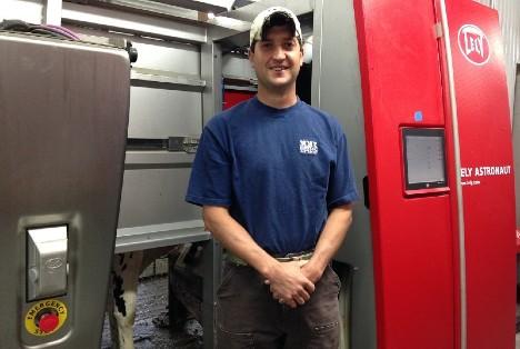 Nate Tullar near robotic milker