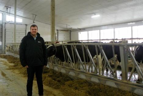Robert Mason in dairy barn