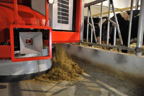 Lely Vector automatic feeding system in action feeding dairy cows.
